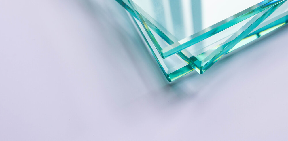Three glass sheets stacked on top of each other. Only part of the corners and edges can be seen in the picture.